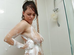Curvy young slut soaps up her booty in the shower